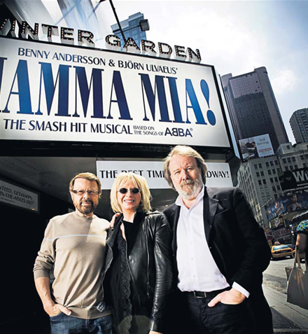 Björn and Benny with Judy Craymer outside the Winter Garden in New York